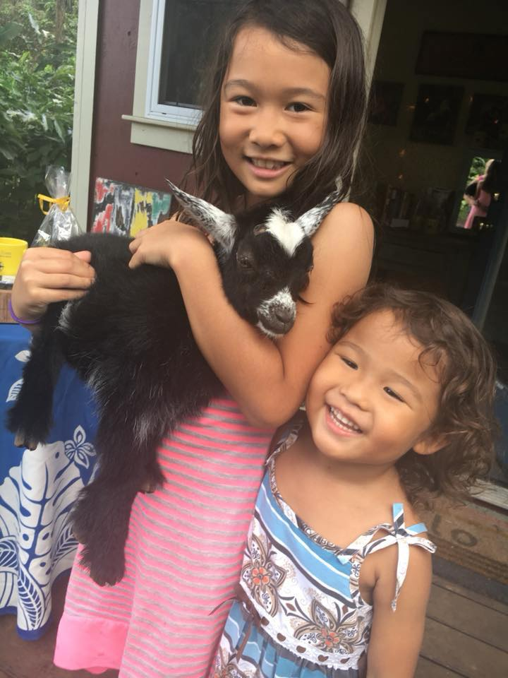 21d girls with baby goat